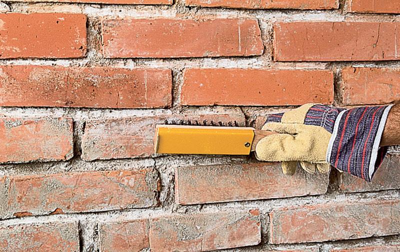 Очистка кирпичной стены