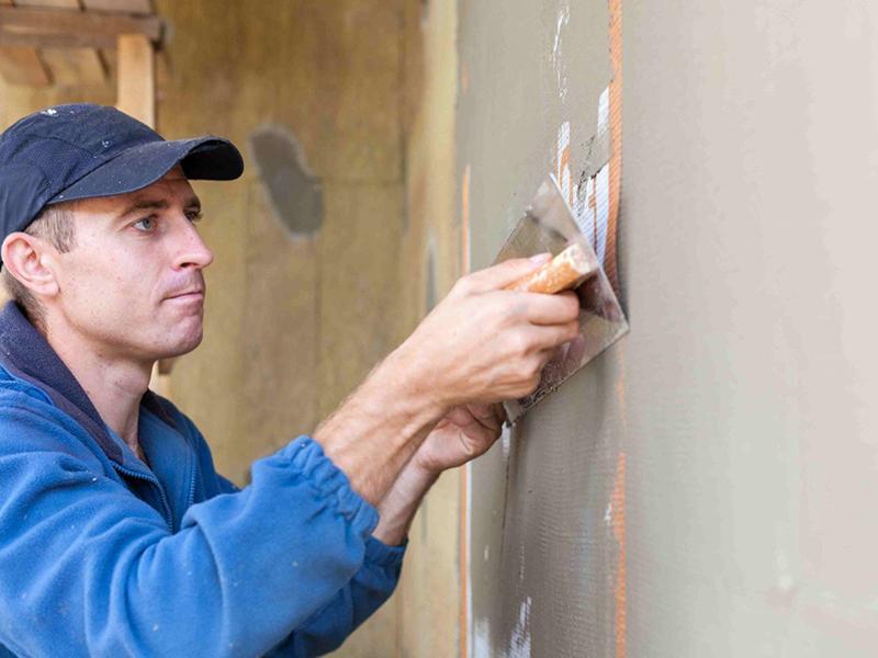Оштукатуривание фасада дома